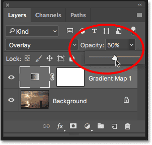 Lowering the opacity of the adjustment layer.