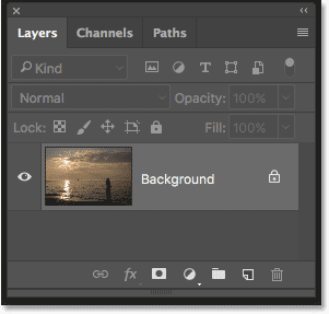 The Layers panel in Photoshop showing the sunset photo on the Background layer